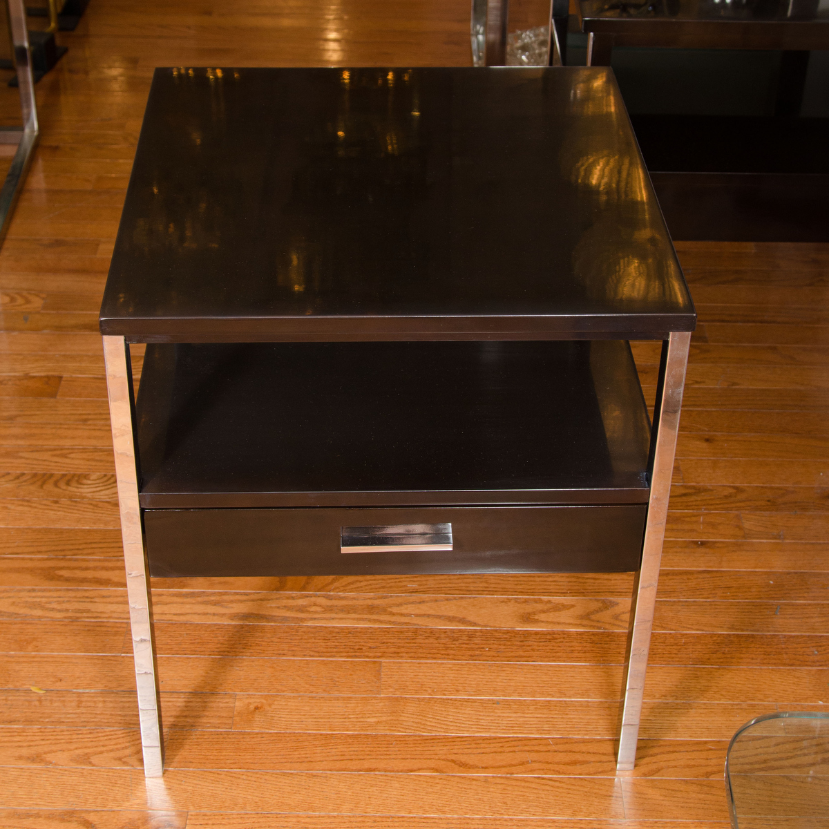 Pair of lacquered wood tables with chrome details side